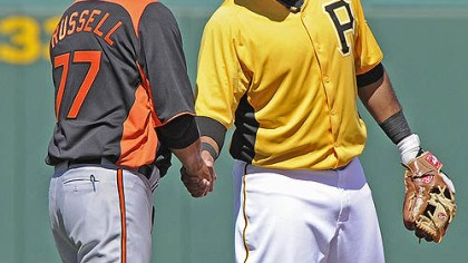 Pedro Alvarez and John Russell Pirates third baseman Pedro Alvarez greets ex-Pirates manager John Russell, currently with the Orioles, Monday.