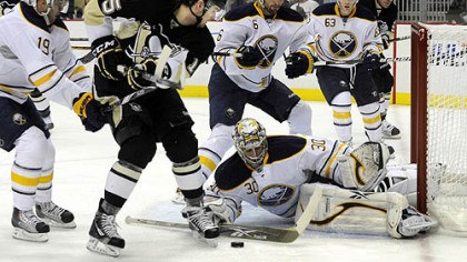 Penguinis 3, Sabres 1 Buffalo's Ryan Miller stops a shot in front of Penguins Dustin Jeffrey.