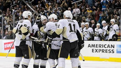 Penguins tie the game Teammates mob Chris Kunitz after his goal late in the third period tied the game.