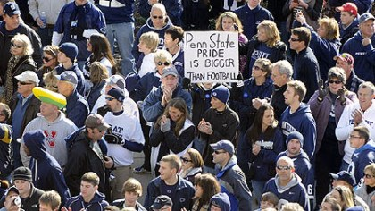 Penn State game Fans line up outside Beaver Stadium to see their team enter the stadium before the start of their team's game against Nebraska today. One sign commented on the sex abuse reporting scandal that rocked the university this week and ended the coaching career of the legendary Joe Paterno.