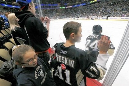 pennsfans kids Pens fans line the glass watching practice before last week's scrimmage.