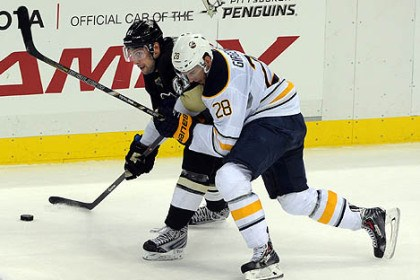 pens sabres 3 Robert Bortuzzo controls the puck under tight defense by Buffalo's Zemgus Girgensons on Saturday.