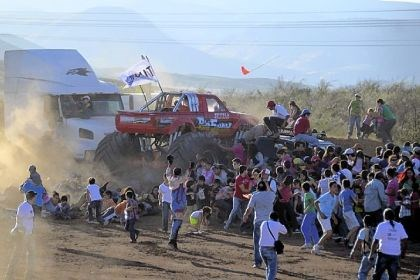 People run People run as an out-of-control monster truck plows through a crowd of spectators Saturday at a Mexican air show in the city of Chihuahua, Mexico. According to authorities, at least eight people were killed and 79 were injured.