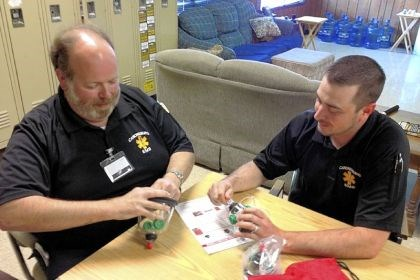 Pet masks Paramedics Kevin David, left, and Steve Carson examine the pet oxygen mask kit donated to Canonsburg General Hospital Ambulance Service by Invisible Fence Brand of Western Pennsylvania.