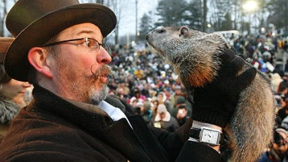 Phil delivers the bad news Punxsutawney Phil is held by Ben Hughes after emerging this morning from his burrow on Gobblers Knob in Punxsutawney. Phil saw his shadow and forecast six more weeks of winter weather.