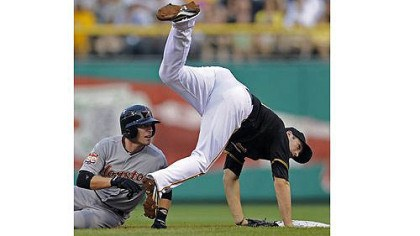 pirates Astros third baseman Scott Moore tags out Pirates Casey McGehee.
