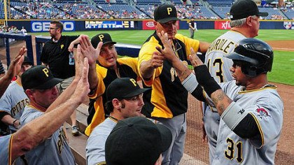 Pirates 9, Braves 3 Jose Tabata #31 is congratulated by teammates after scoring against the Atlanta Braves.