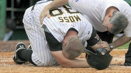 Pirates' Brandon Moss The Pirates' Brandon Moss is checked by athletic trainer Brad Henderson after spraining his left ankle in the seventh inning.