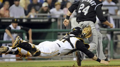 Pirates catcher Ryan Doumit Pirates catcher Ryan Doumit stretches out to tag out Colorado's Ian Stewart near third base to end the sixth inning last night at PNC Park.
