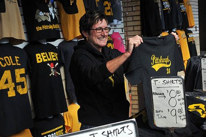 pirates merch Emily Dausch displays Pirates regalia at a Strip District stand today before the Pirates-Cardinals game.