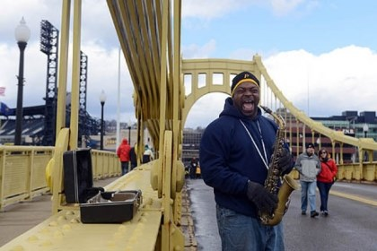 PiratesOpeningDay_4 Reggie Howze of Garfield plays the saxophone on the Roberto Clemente Bridge before the start of the Pittsburgh Pirates' home opener.