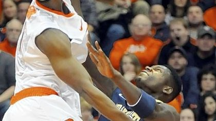 Pitt Syracuse' C.J. Fair dunks against Talib Zanna Monday in the first half at the Carrier Dome in Syracuse, N.Y.