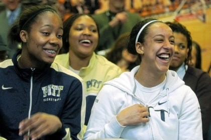 Pitt players Pitt players Asia Logan, left to right, Marvadene Anderson and Brianna Kiesel watch as Suzie McConnell-Serio is announced as the new head women's basketball coach for the University of Pittsburgh.