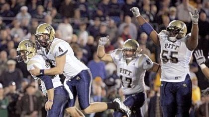 Pittb Pitt kicker Conor Lee,left, celebrates with holder Andrew Janocko (4) after kicking the winning field goal in the fourth overtime period against Notre Dame in 2008.