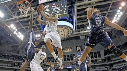 PittNorthFlorida.jpg Cameron Wright gets past North Florida's Andy Diaz, right, for a shot in the first half Saturday at Petersen Events Center.