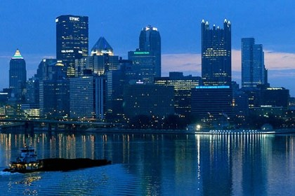 Pittsburgh skyline in blue What is it about Pittsburgh that city expats often feel after they leave?
