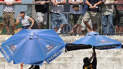 Players in the bullpen Players in the bullpen struggle with umbrellas as fans watch yesterday in Clearwater, Fla.