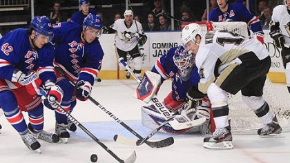 Players on the ice New York Rangers center Artem Anisimov (42) and Ryan McDonagh (27) help Rangers goalie Henrik Lundqvist defend the goal as Penguins' Chris Kunitz (14) looks on.
