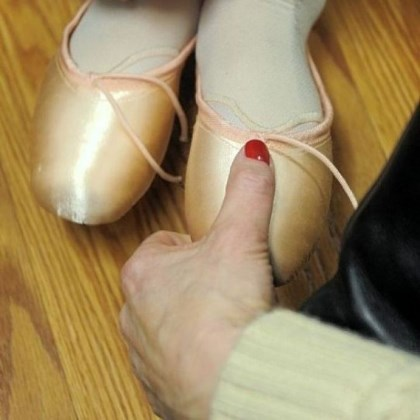 Pointe shoes for ballet students A Pittsburgh Ballet School student is checked to see if her first pair of pointe shoes fit correctly.