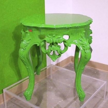 PolArt's baroque outdoor table PolArt's baroque outdoor table looks good enough to use indoors in trendy green.