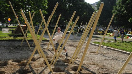 Pole maze at Allegheny Commons Park playground Mike Jeffrey of Indiana Township and with Jeffrey Associates, walks through a maze of poles at the new KaBOOM! playground at Allegheny Commons Park on the North Side.