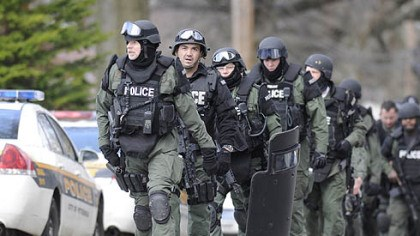 Police at the scene Pittsburgh police file up Fairfield Street following a deadly stand-off in Stanton Heights today,.