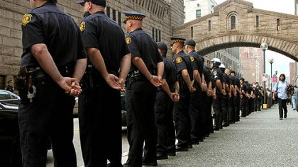 Police show of force More than 100 officers from Pittsburgh and surrounding areas stood at attention as the families of Pittsburgh Police Officers Eric G. Kelly, Stephen J. Mayhle and Paul J. Sciullo II arrived at the Allegheny County Courthouse.