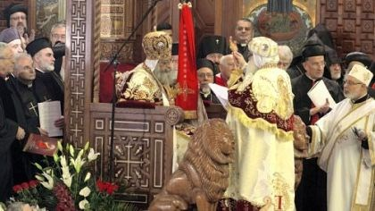 Pope Tawadros II sits Pope Tawadros II, 60, sits Sunday on the throne of St. Mark, the Coptic church's founding saint, in the Coptic cathedral in Cairo during an elaborate ceremony lasting nearly four hours, attended by Egypt's Muslim prime minister and a host of Cabinet ministers and politicians.