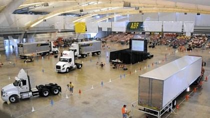 Professional truck drivers Drivers maneuver their tractor-trailers around a tight course yesterday in Exhibit Hall A at the David L. Lawrence Convention Center in the 2009 National Truck Driving Championships sponsored by the American Trucking Associations.
