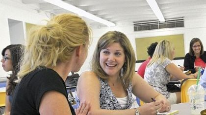 Propel school Kim Hoerr, left, a first-grade teacher, and Betsy Miller, center, who teaches kindergarten, work with other teachers to create a mission statement for the new Propel school on the North Side.