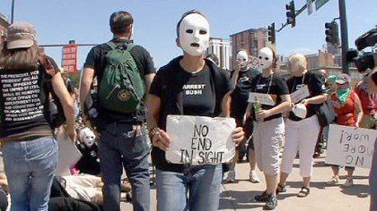 Protest Lori Arbiter, of New York, takes part in the March of the Dead to protest the war in Iraq yesterday in Denver.