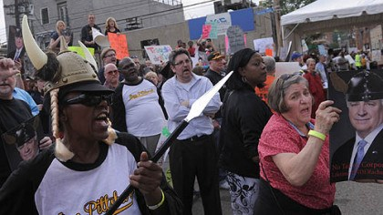 Protest Stacy Childs, left, and other protesters shout as people arrive at the Pittsburgh Opera's Strip District headquarters for an event honoring Governor Tom Corbett, who received Saturday a lifetime achievement award.