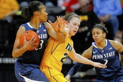 PSUwin Iowa guard Samantha Logic, center, puts pressure on Penn State forward Ariel Edwards Thursday at Carver-Hawkeye Arena in Iowa City, Iowa.