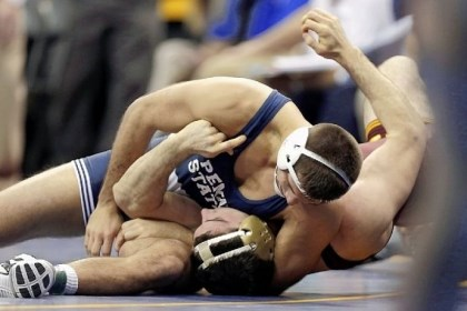 QuentinWright Penn State's Quentin Wright, top, pins Minnesota's Scott Schiller in their 197-pound quarterfinal match at the NCAA wrestling championships Friday in Des Moines, Iowa.