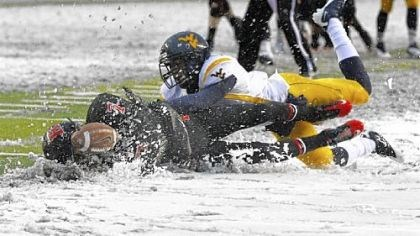 Quran Pratt Rutgers' Quran Pratt, left, can't hold onto a pass in the snow after being hit by West Virginia's Pat Miller.