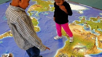 R.J. Bernard, 5, and his sister Rielle, 2 R.J. Bernard, 5, and his sister Rielle, 2, scrutinize an unusually large map of the world at the National Children's Museum.