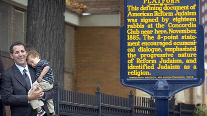 Rabbi Aaron Bisno Rabbi Aaron Bisno of Rodef Shalom Congregation holds son Adam, 2, shortly after the unveiling yesterday of a marker noting the historic Pittsburgh Platform on Stockton Street on the North Side.