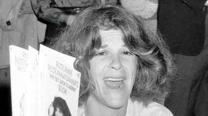 radner In this September 1982 photo, actress Gilda Radner holds up copies of her books at a New York bookstore.