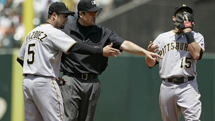 Ramon Vazquez, Mike DiMuro and Andy LaRoche Pirates shortstop Ramon Vazquez argues with second base umpire Mike DiMuro as third baseman Andy LaRochecovers his face with his glove after Giants infielder Juan Uribe was called safe on a steal at second base in the fifth inning.