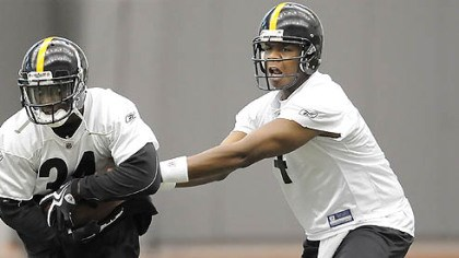 Rashard Mendenhall and Byron Leftwich Steelers quarterback Byron Leftwich hands off to Rashard Mendenhall.
