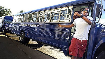 Ready to clean Penn State's football team arrives on buses yesterday morning to clean the stands at Beaver Stadium.