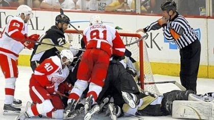 Red Wings swarmed Marc-Andre Fleury The Red Wings swarmed Marc-Andre Fleury late, including this pileup in the crease, but they could not score the tying goal.