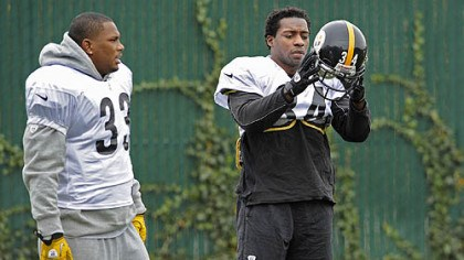 Redman and Mendenhall Isaac Redman and Rashard Mendenhall talk during practice at the team's South Side facility.