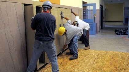 removing school lockers Workers with NEJ Abatement of Penn Hills remove school lockers at the former Prospect Middle School on Mount Washington.