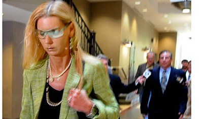 Renee Konias Renee Konias, with her husband, Kenneth Konias Sr. following, leaves after attending her son's preliminary hearing at the Pittsburgh Municipal Court on Friday.