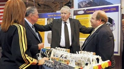Rep. John P. Murtha Rep. John P. Murtha, D-Johnstown, center, speaks on Friday with, from left, Karen Stiles, Jack Sweet and Joe Calin of Argon, an electronic defense contractor, at the Showcase for Commerce at the Cambria County War Arena in Johnstown.