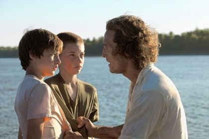"Review: ""Mud"" A boat wedged high in a tree on a Mississippi River island brings together Tye Sheridan, Jacob Lofland and Matthew McConaughey in ""Mud."""