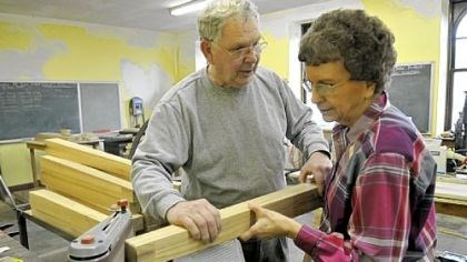 Richard and Betty Bischoff Richard Bischoff instructs his wife, Betty, while sanding boards for tables being made at First Presbyterian Church in New Brighton.