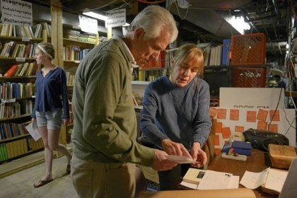 Richard Ducote and Suzanne Powell Volunteer Richard Ducote and Book 'Em associate director Suzanne Powell package books Sunday while Katherine Anderson, 19, picks out books for prisoners at the Thomas Merton Center in Garfield.