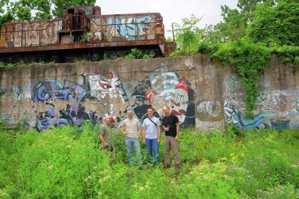Rick Darke and friends Rick Darke, far right, has been photographing the Carrie Furnaces for years. This is his favorite piece of graffiti. With him are, from left, Ron Baraff of Rivers of Steel, and Chris McGinnis and Sean Derry, art professors who will create installations on the site later this year.